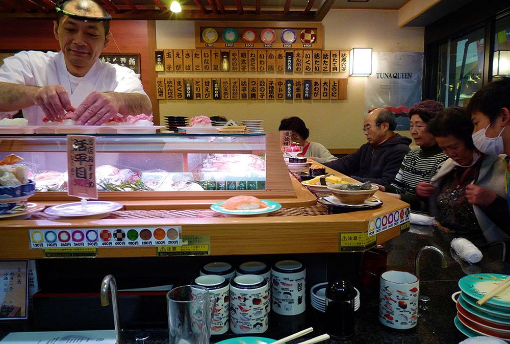 conveyor belt sushi is some of the food to try in Japan