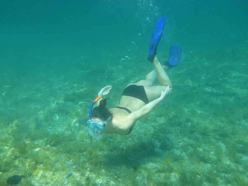 a woman snorkeling underwater