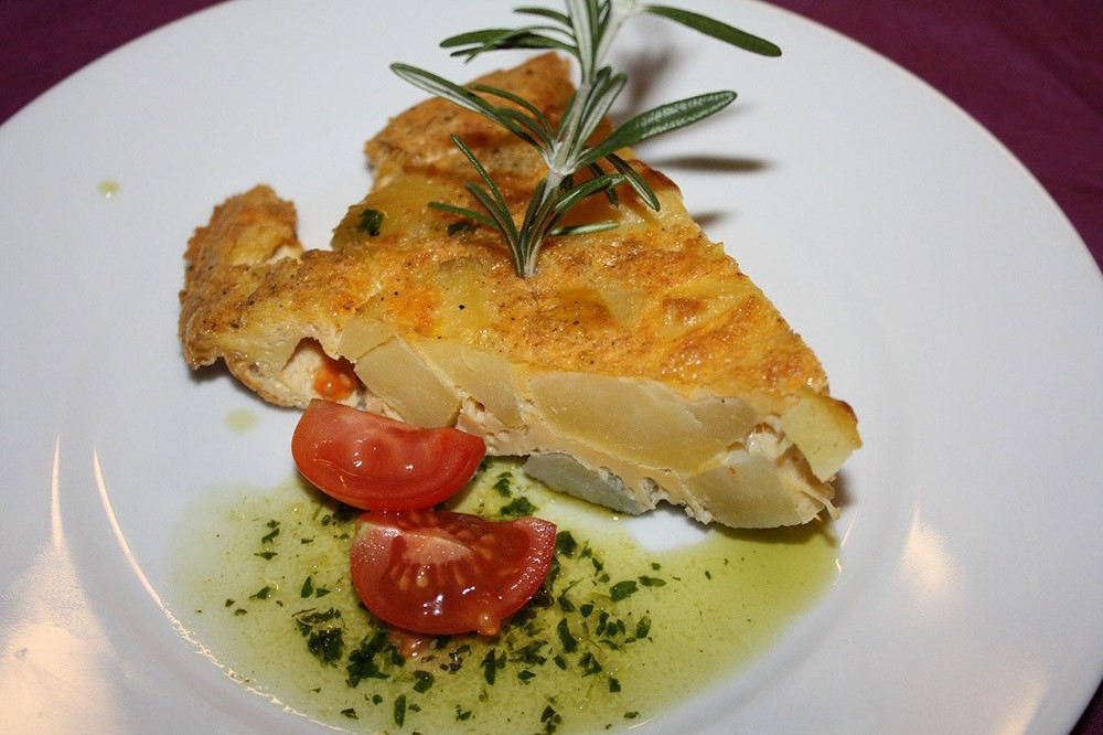 a slice of tortilla de patatas