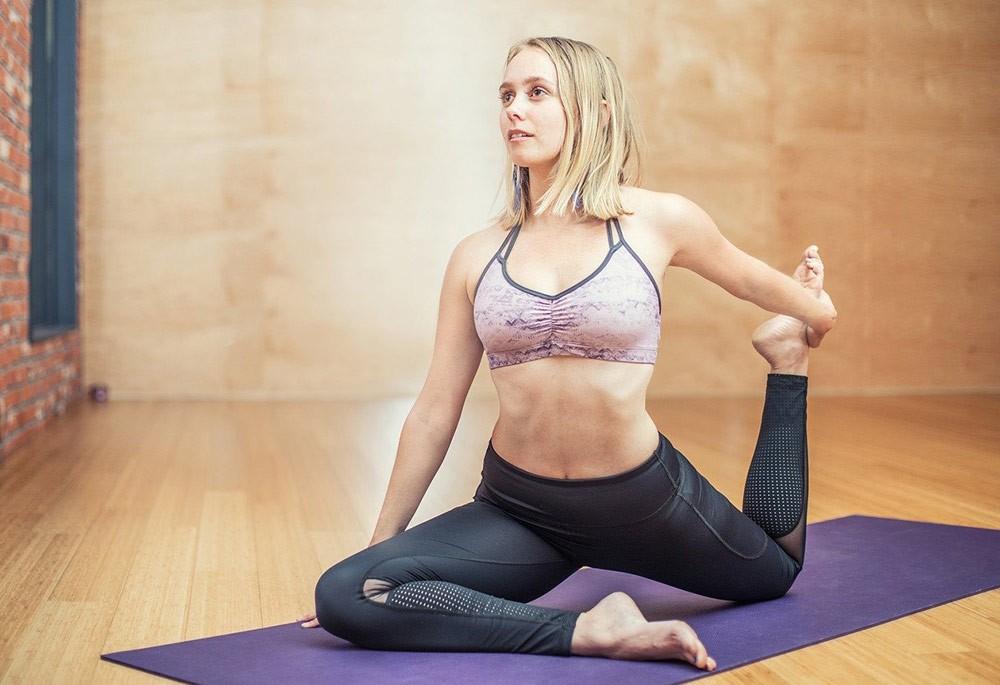 woman exercising on a yoga mat