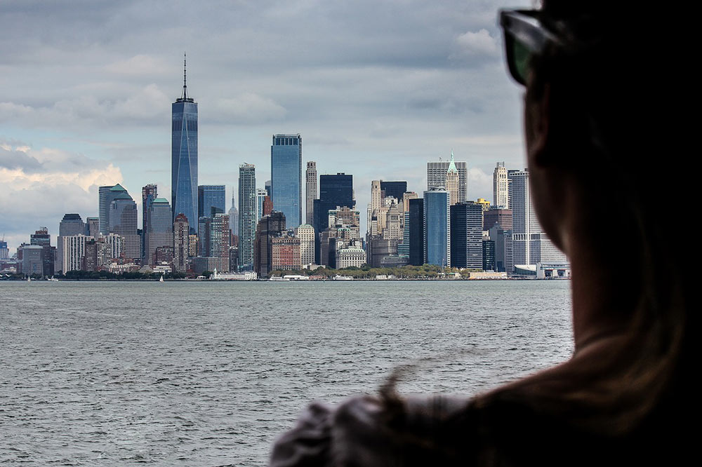 woman looking out over New York after moving there